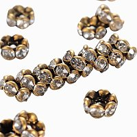 NBEADS 200 pcs 5mm Grade AAA Brass Rhinestone Spacer Round Rondelle Beads Nickel Free Wavy Edge, 2.5mm Thick, Hole: 1mm, Antique Bronze Metal Color