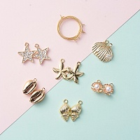 NBEADS DIY Earring Making, 304 Stainless Steel Hoop Earrings, Alloy Rhinestone Pendants, Star and Electroplate Cowrie Shell Pendants, Golden, 25mm; Pin: 0.7mm, 12pcs/bag; Pendant: 12~24x10~21x3~8mm, 12pcs/bag