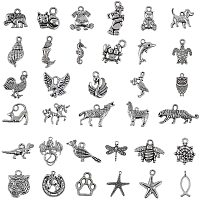 NBEADS 100g Mixed Shapes Tibetan Style Alloy Pendants, 30 Random Mixed Kinds of Metal Seahorse Dolphin Dog Animal Charm Pendants for DIY Necklace Bracelet Arts Projects, Antique Silver